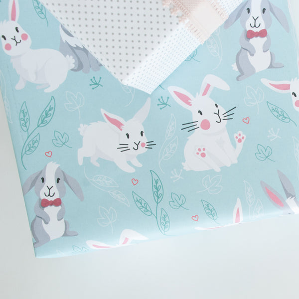 Examples of how the bunny gift wrap looks on boxes