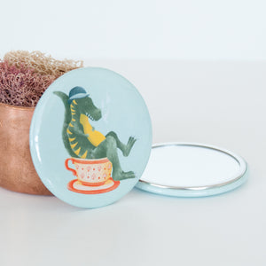 T Rex sitting in a Tea cup illustrated travel pocket mirror
