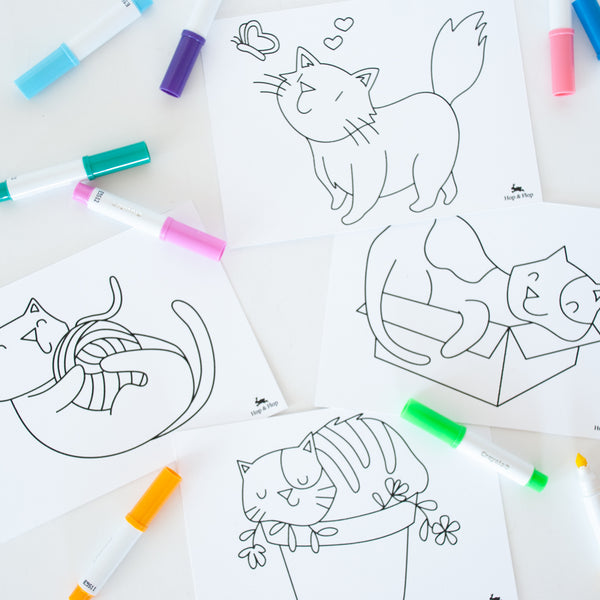 Close up of the 4 colouring cat postcards