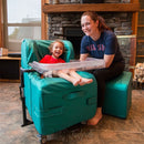 Mom and daughter in living room in her Chill-Out Rocker Chair by Freedom Concepts.