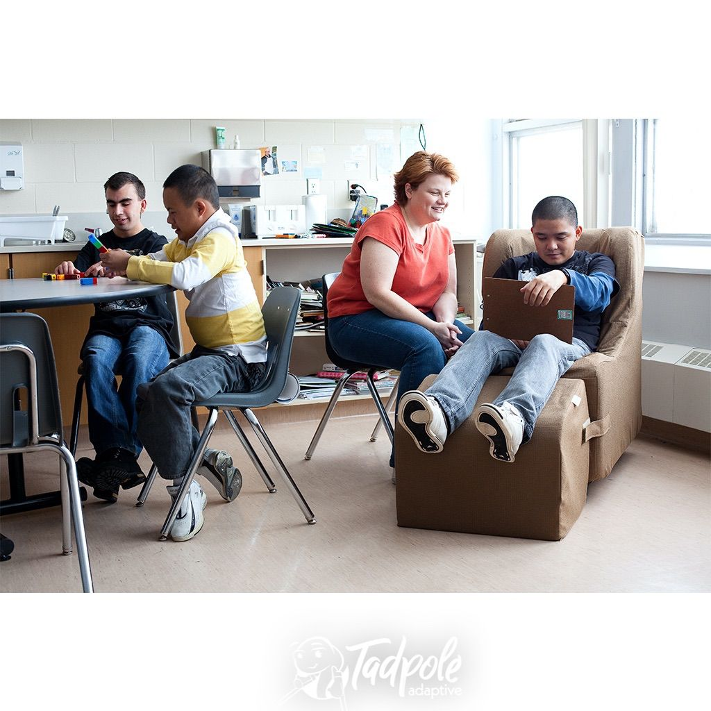 Teeager in the classroom in his Chill-Out Rocker Chair by Freedom Concepts.