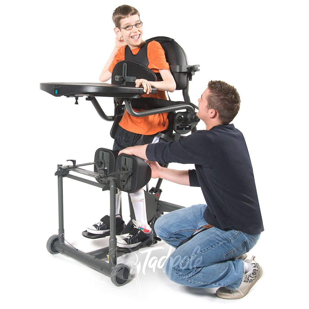EasyStand Evolv E3 Medium, Boy standing with therapist helping