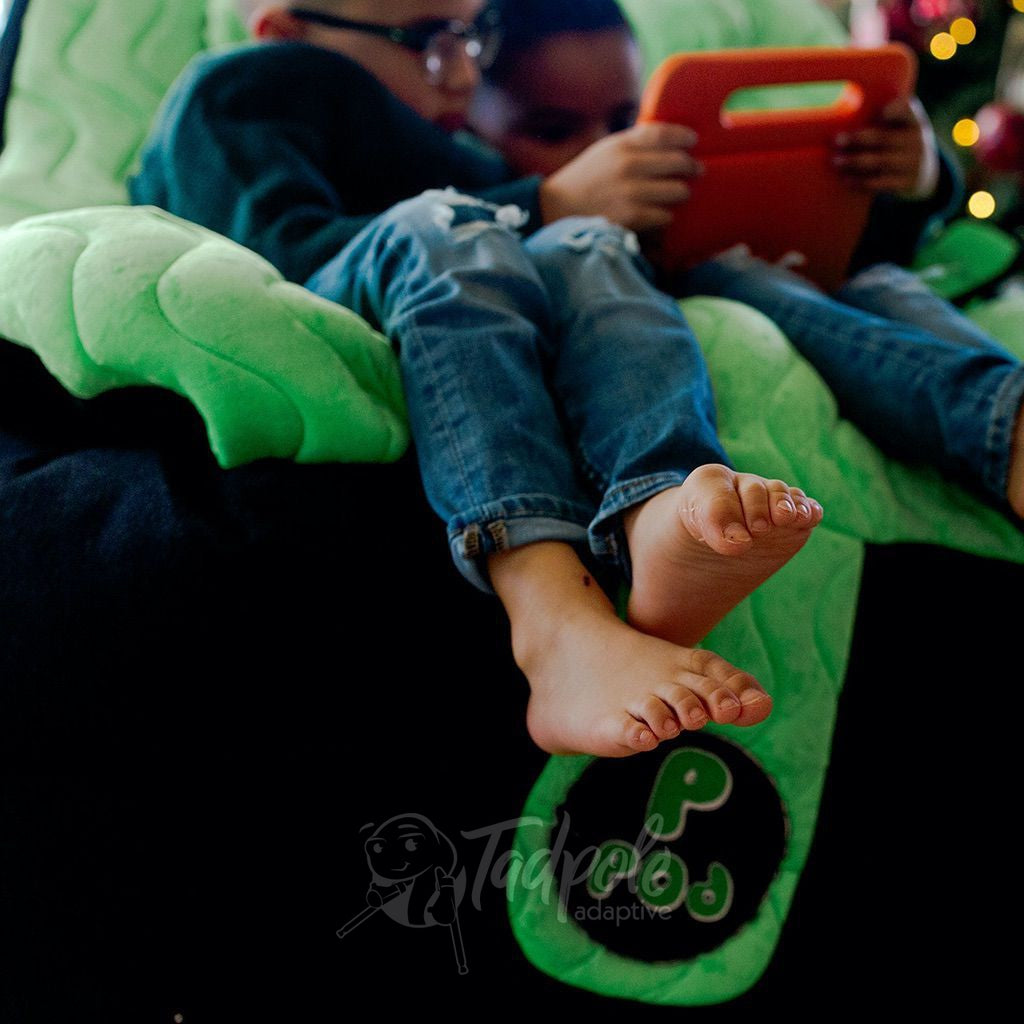 Brothers, with dangling feet by Christmas Tree, in their Green P Pod.