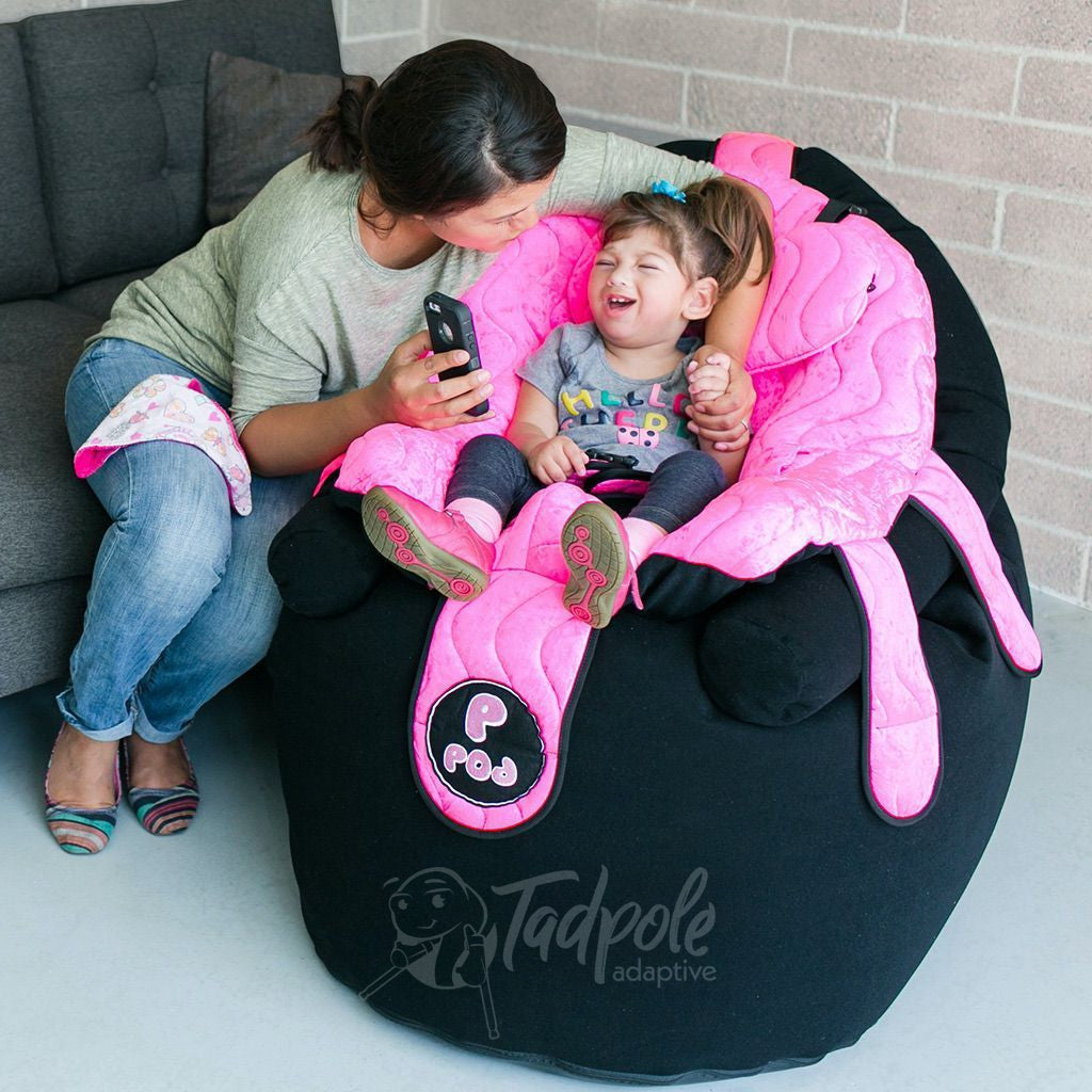Mom and daughter interacting wile she site in her P Pod Chair in Mermaid Pink.
