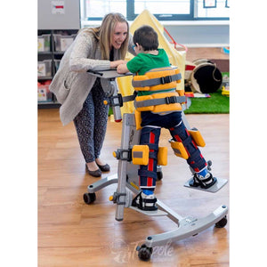 Young boy with therapist in his Jenx Standz Prone special needs stander.