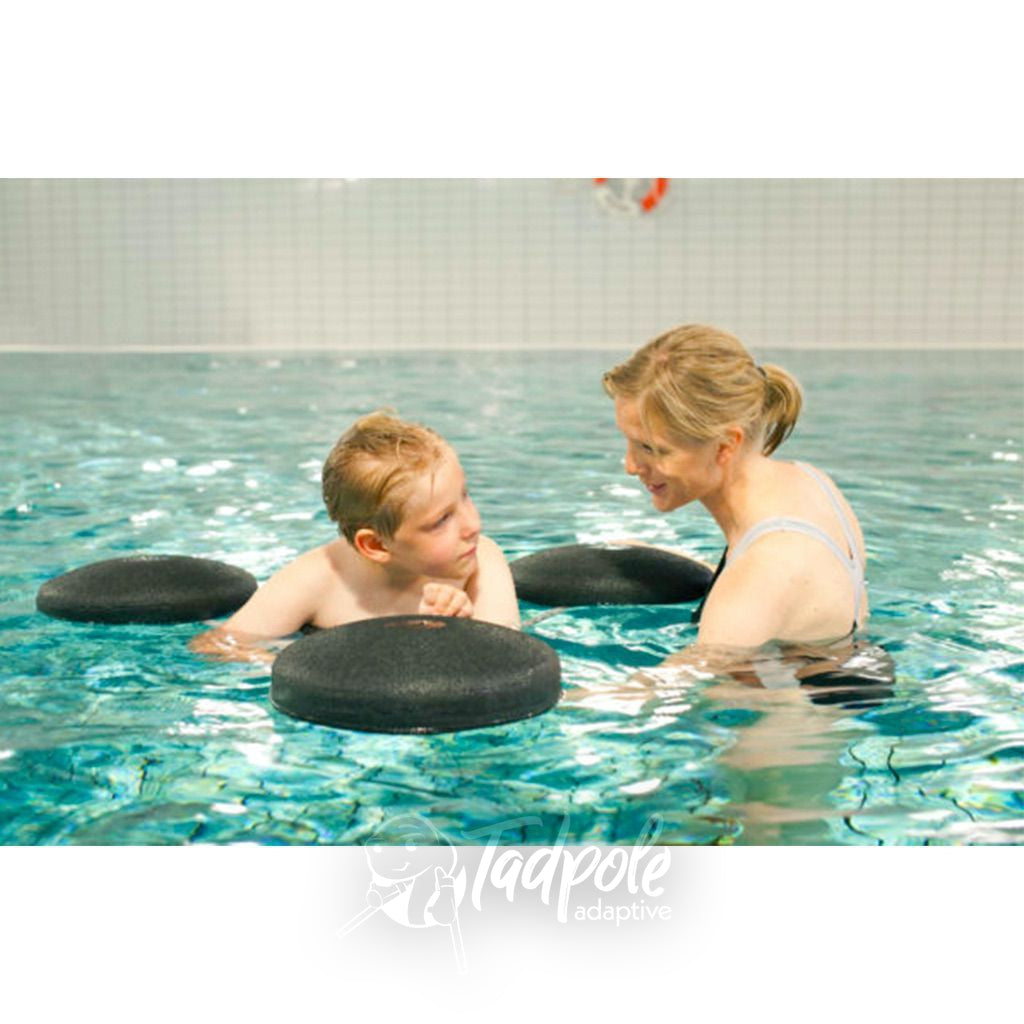 Aquatic therapy for child with special needs using The Pirat Floating Aid by Krabat.