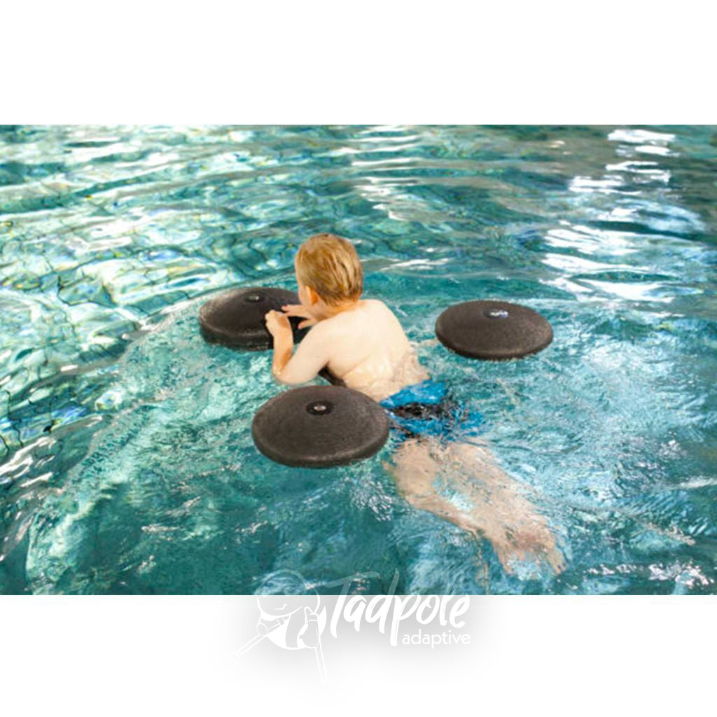Top view of boy swimming independently in pool with the Pirat Floating Aid by Krabat.