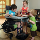 Boy, at home with his brother and sister playing while in his Leckey Everyday Activity Seat.