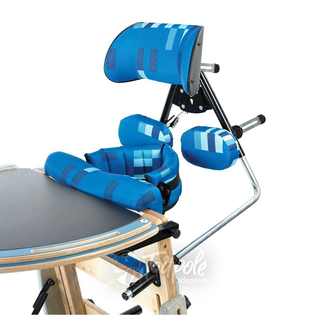 Leckey Freestander shown with headrest angle adjustments and tray.