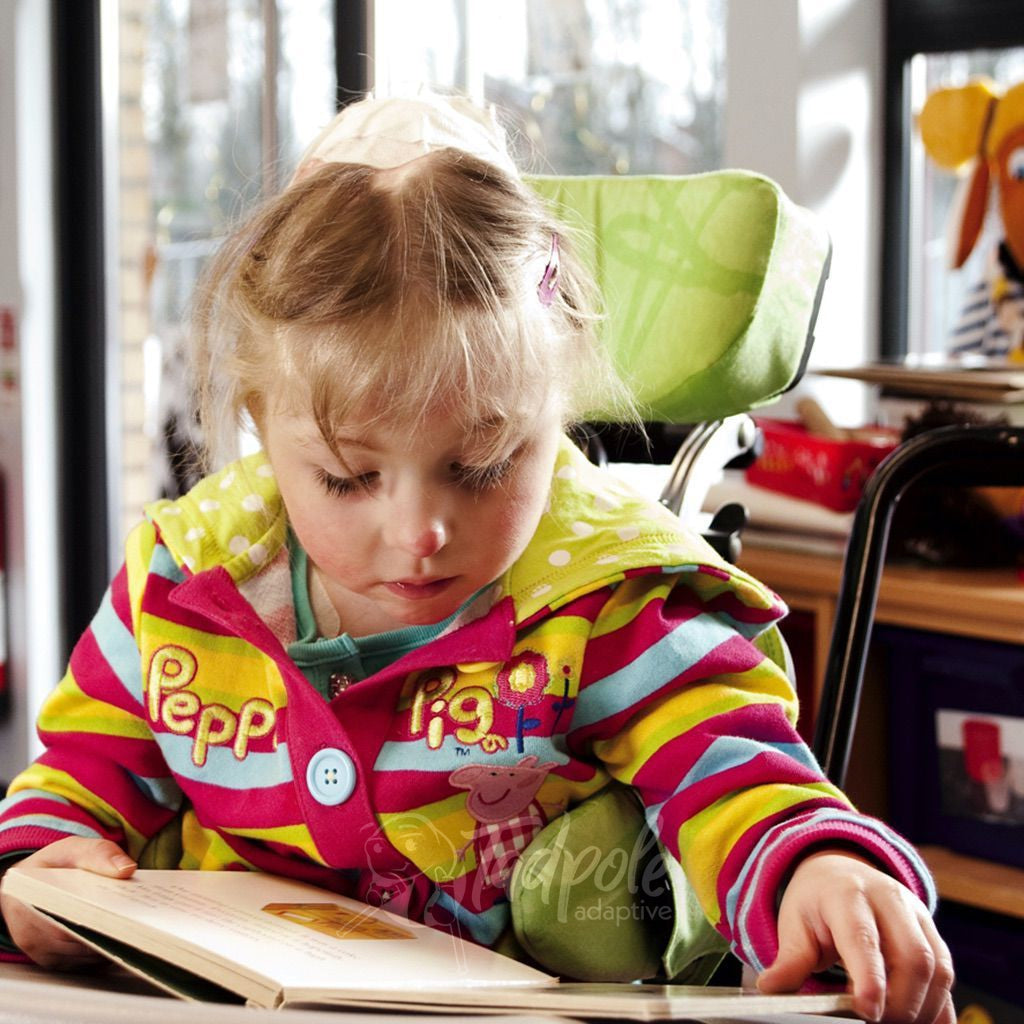 Leckey Squiggles Seating System Little girl reading at the table