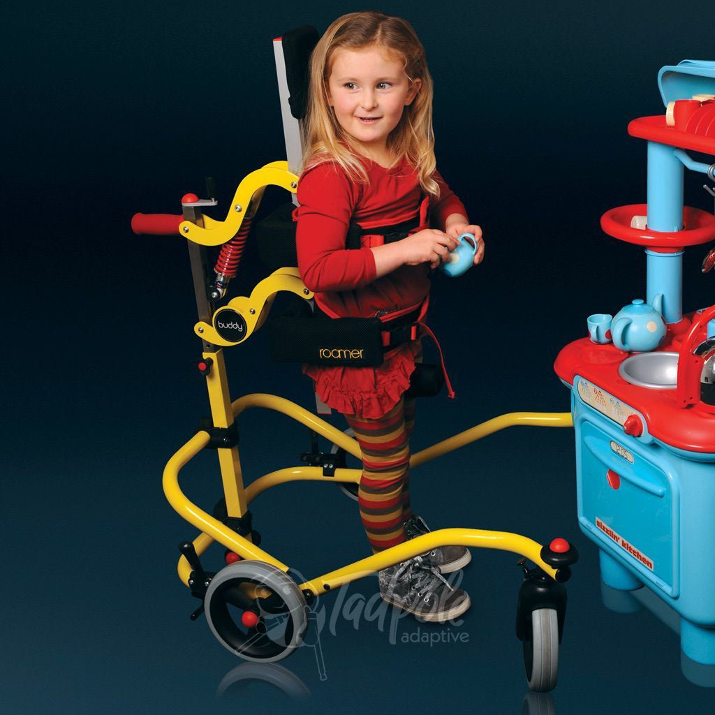 Young Girl in her Buddy Roamer Anterior Gait Trainer, with kitchen playset.