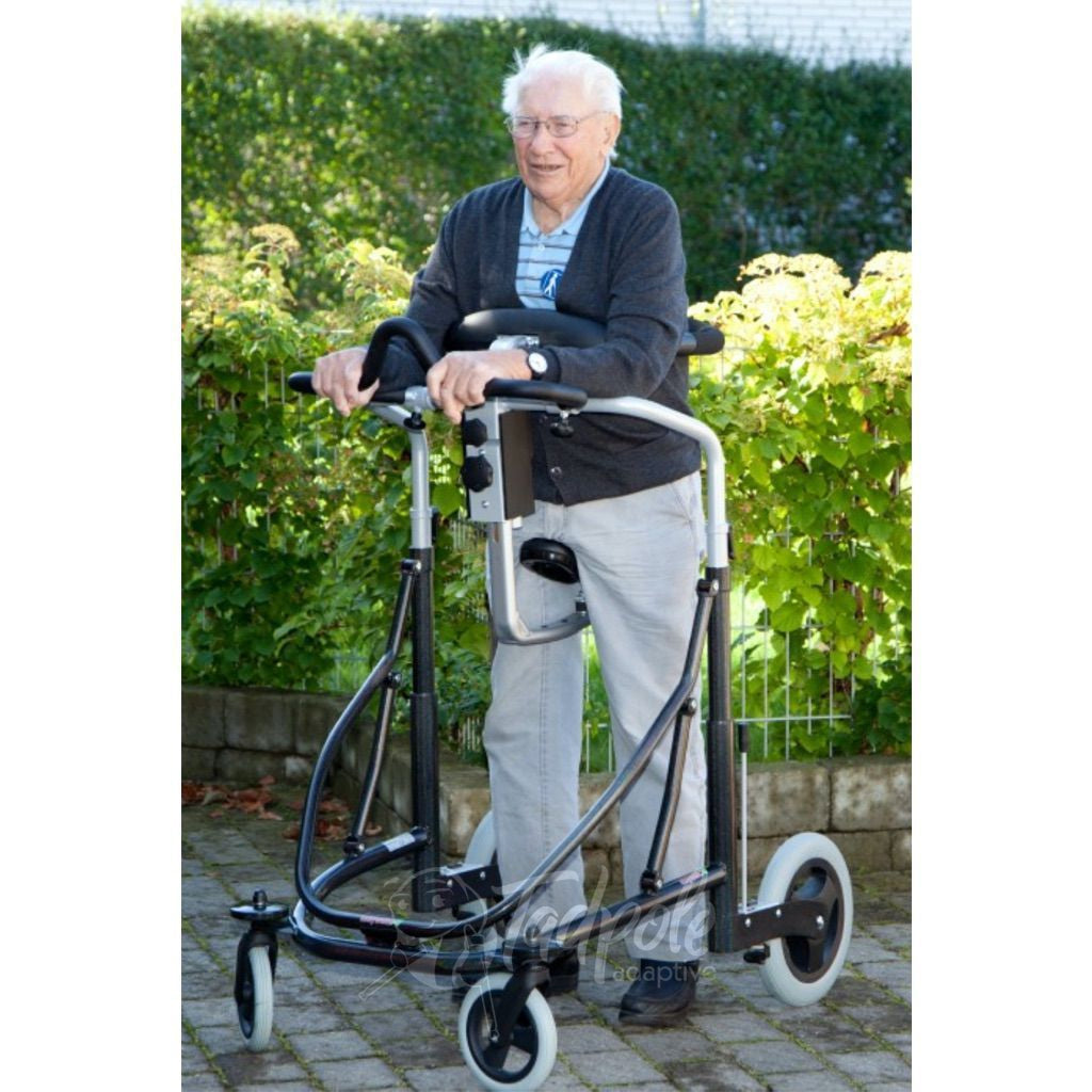 Older gentleman in his Pacific Rehab Meyland Smith Meywalk MK4 Gait Trainer, largest size.