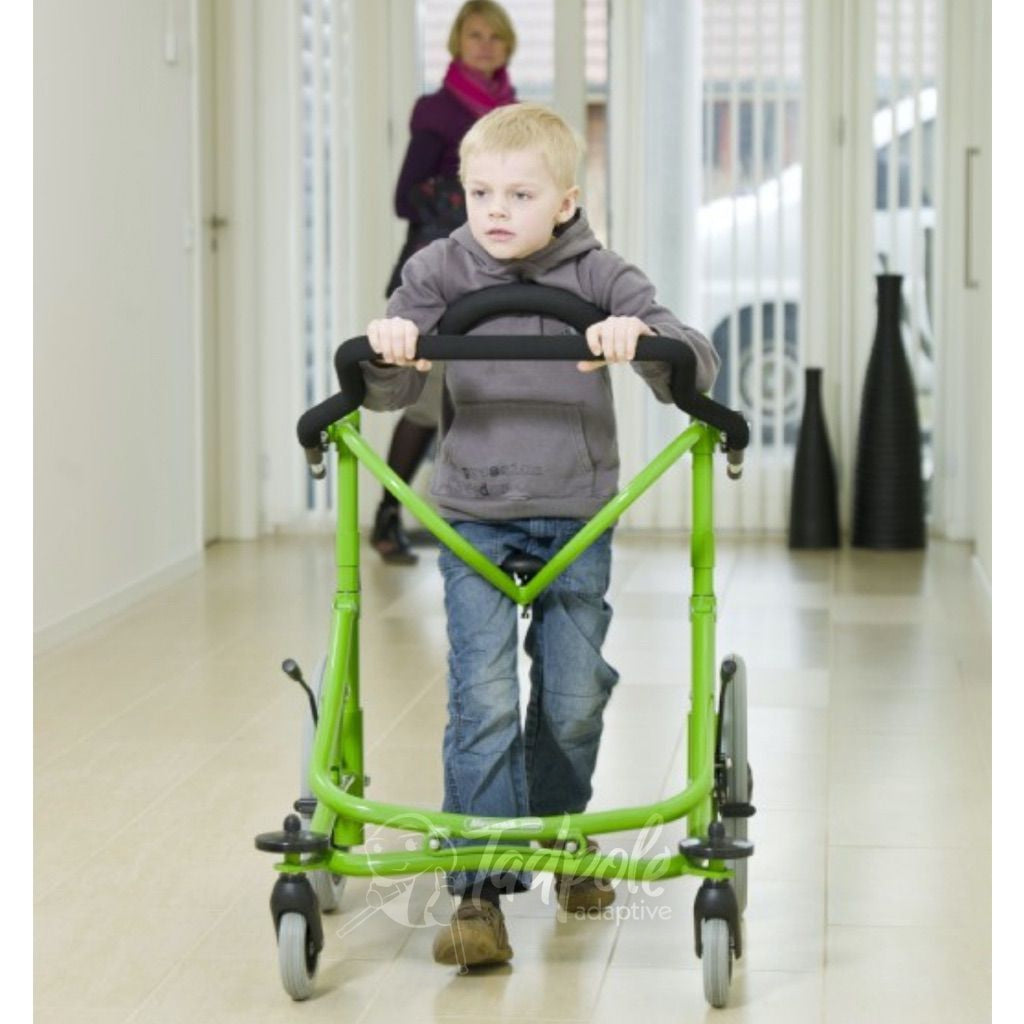 Meywalk Young boy with green Meywalk 2000 Gait Trainer By Pacific Rehab walking down hallway.