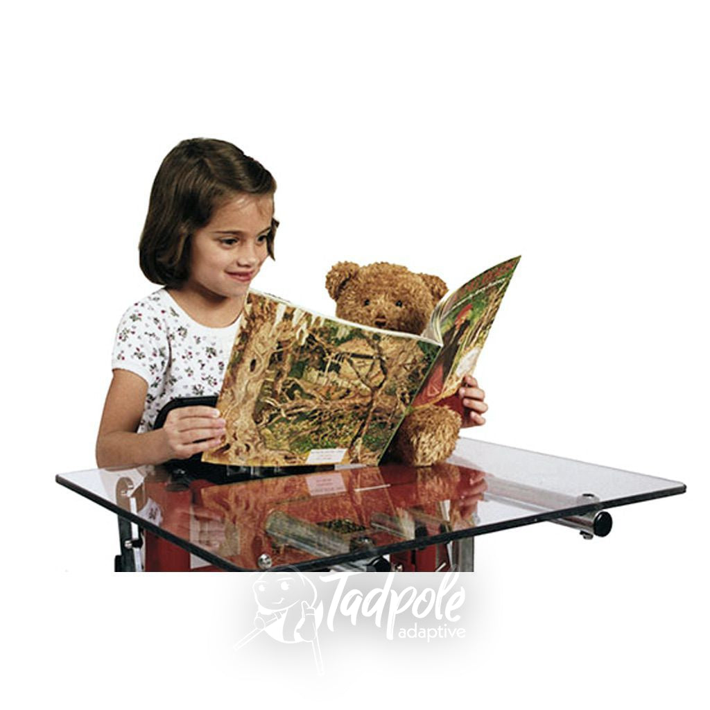 Little girl standing and reading using tray in her Prime Engineering Kidstand III.