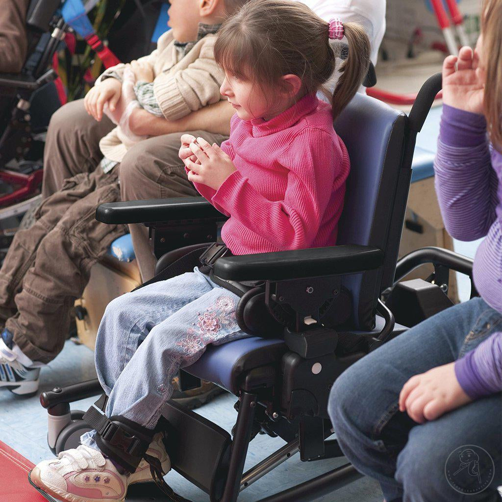 Little girl enjoying a performance in her Rifton Activity Chair with Hi-Low Base.