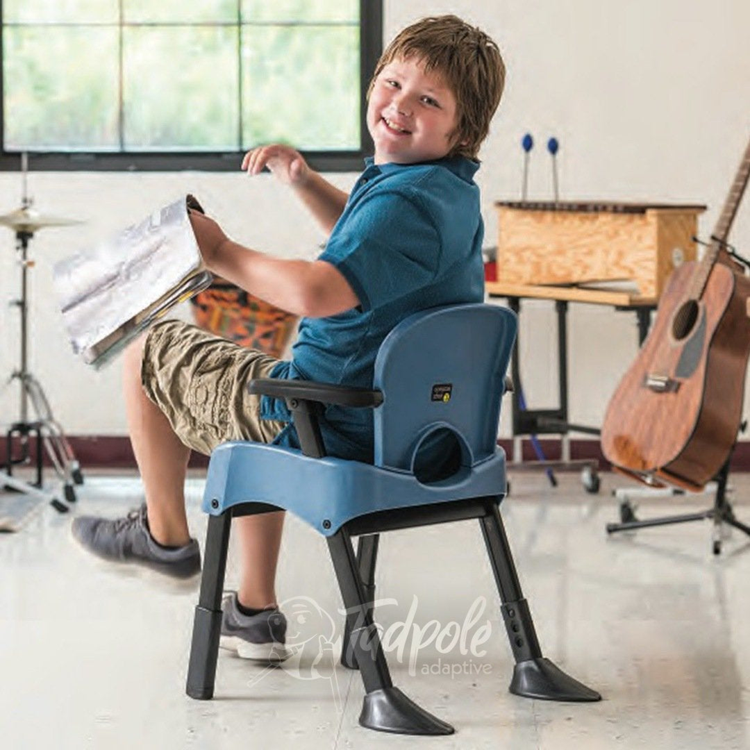 Boy in Rifton Compass Chair in classroom, featuring tip-proof legs.