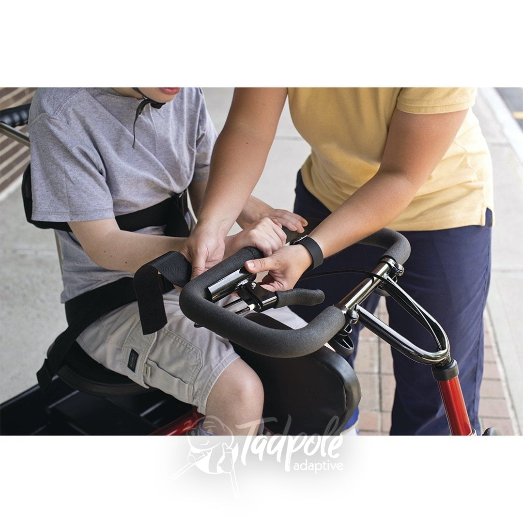Strapping in securely on the Rifton Trike.