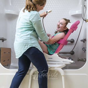 Young girl in Rifton Wave, slightly reclined on Tub Transfer Base in shower.