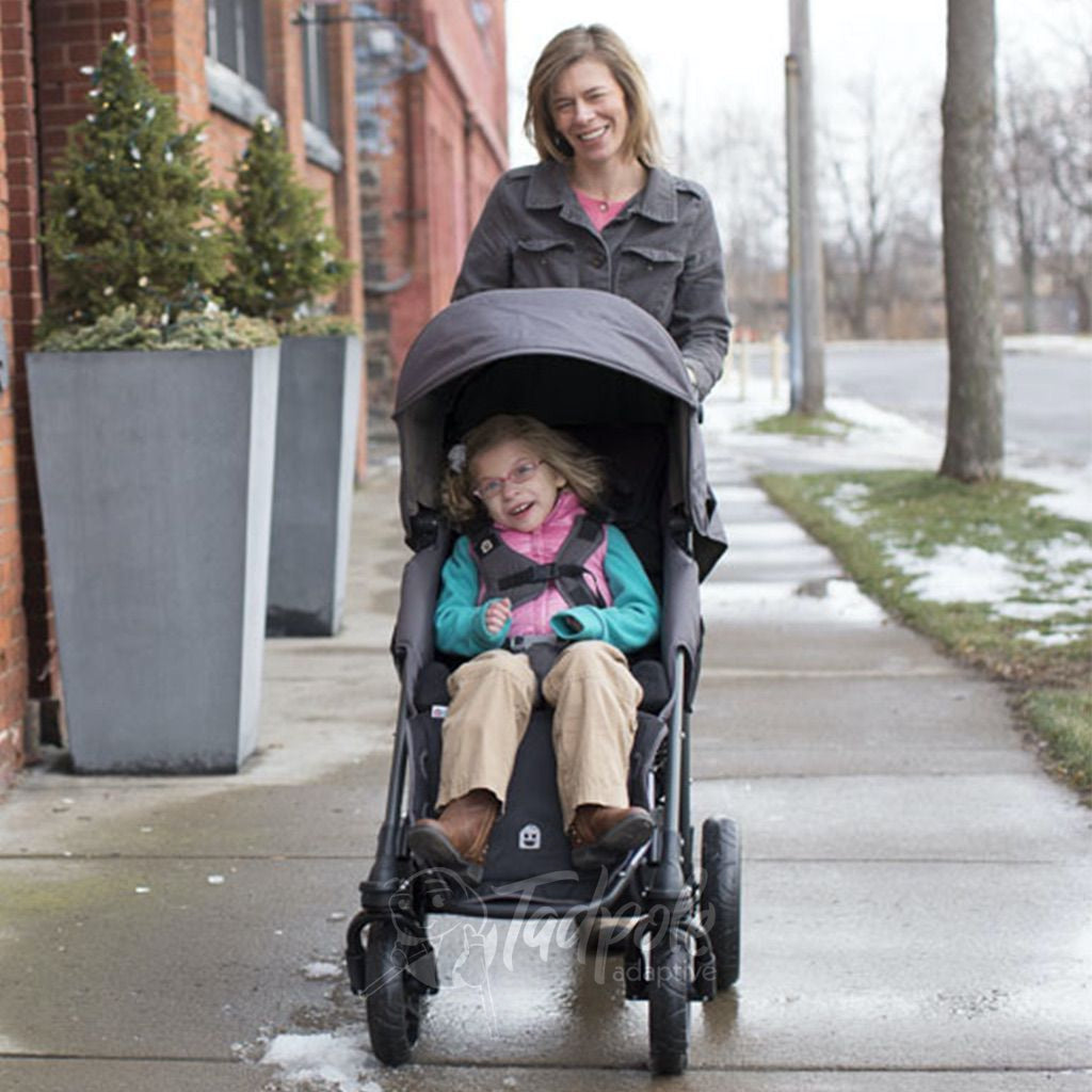 Special Tomato EIO Push Chair,  mom and daughter walking.