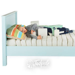 Young boy in bed, in his Jenx Dreama System, in side lying position.
