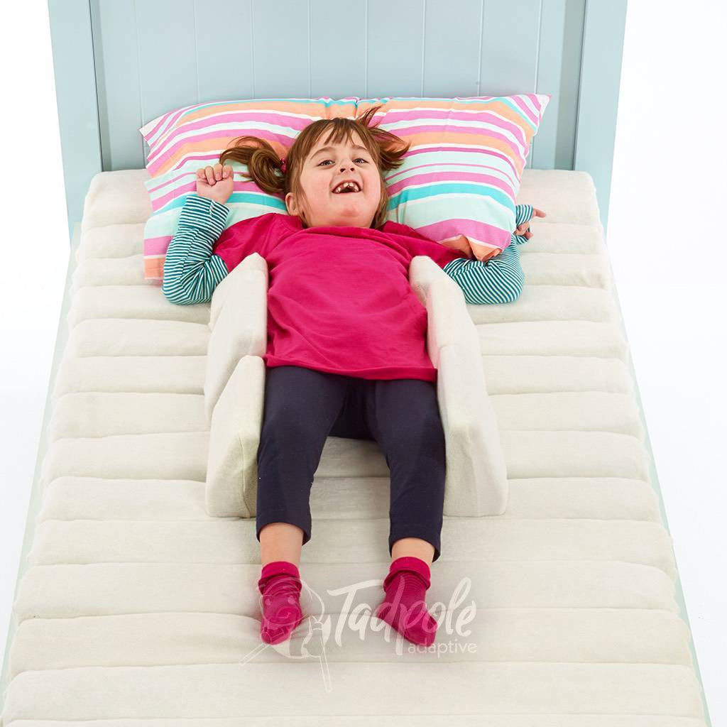 Young girl in bed in her Jenx Dreama - Postural Support Sleeping System, Supine 2