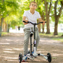 Young boy in park using his Krabat Runner kick bike.