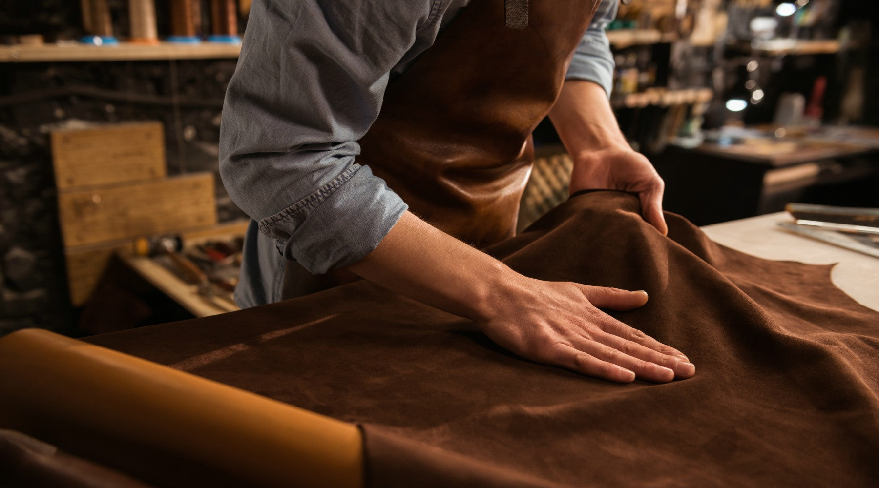 A persons caressing a leather hide