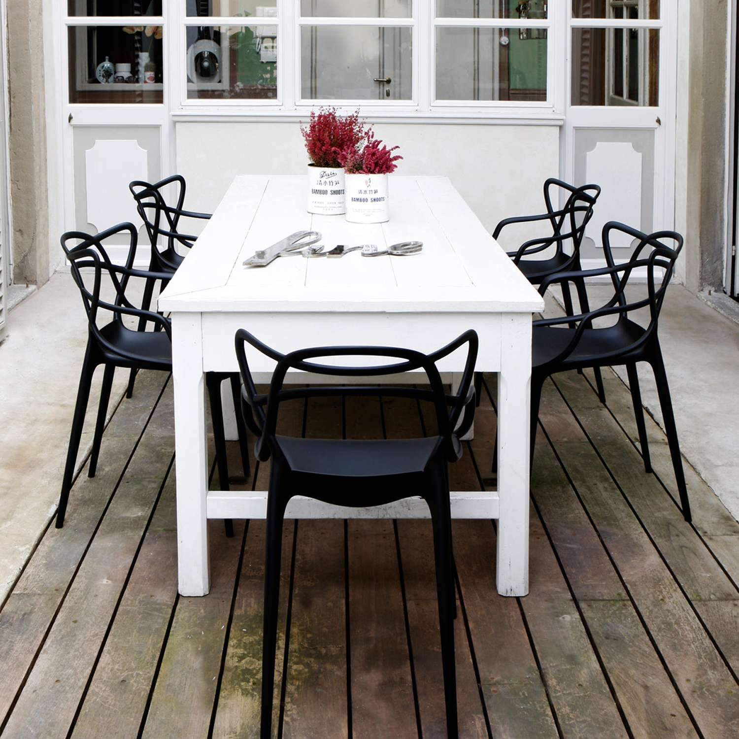 Black Replica Masters Chairs with a table setting