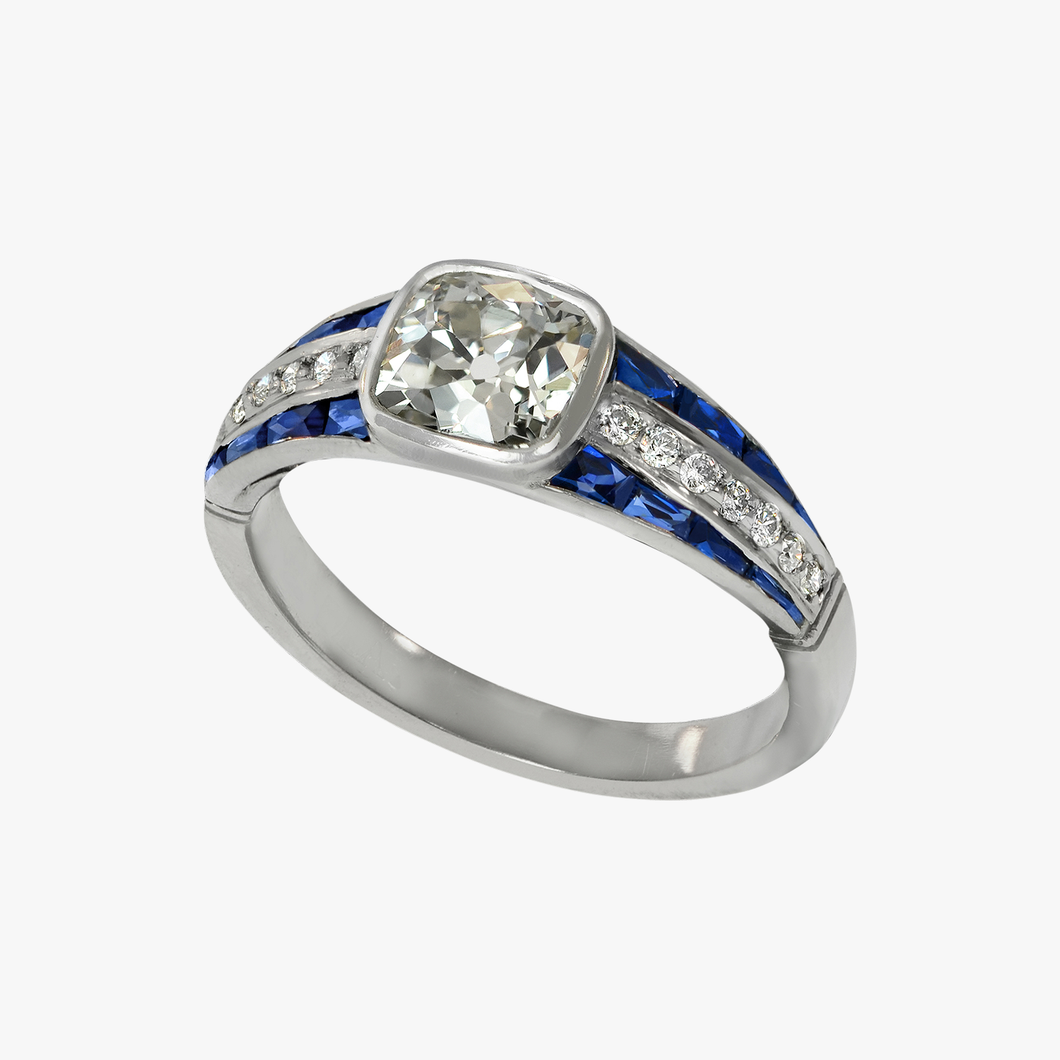 Bezel-Set Diamond Ring with Sapphire Detail
