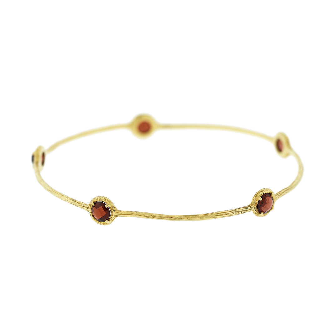 Textured bangle with Garnets