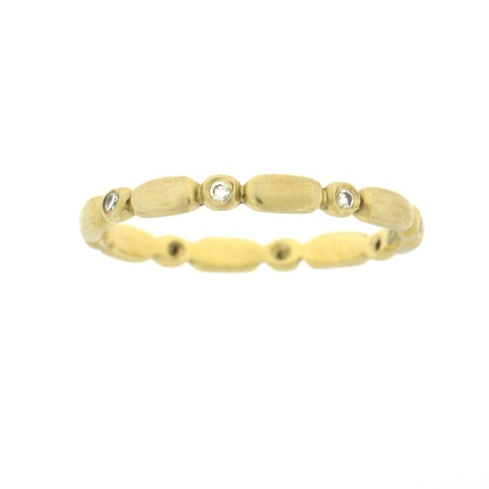 Delicate Gold and Flush Diamond Band