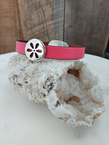 Bubblegum pink fine Italian leather is accented with a sweet, cut-out, silver daisy. This bracelet is secured with an oval magnetic clasp.