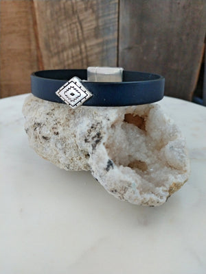 Handsome navy fine Italian leather is accented with a southwestern diamond patterned slider. This bracelet stays secure with a southwestern motif magnetic clasp.
