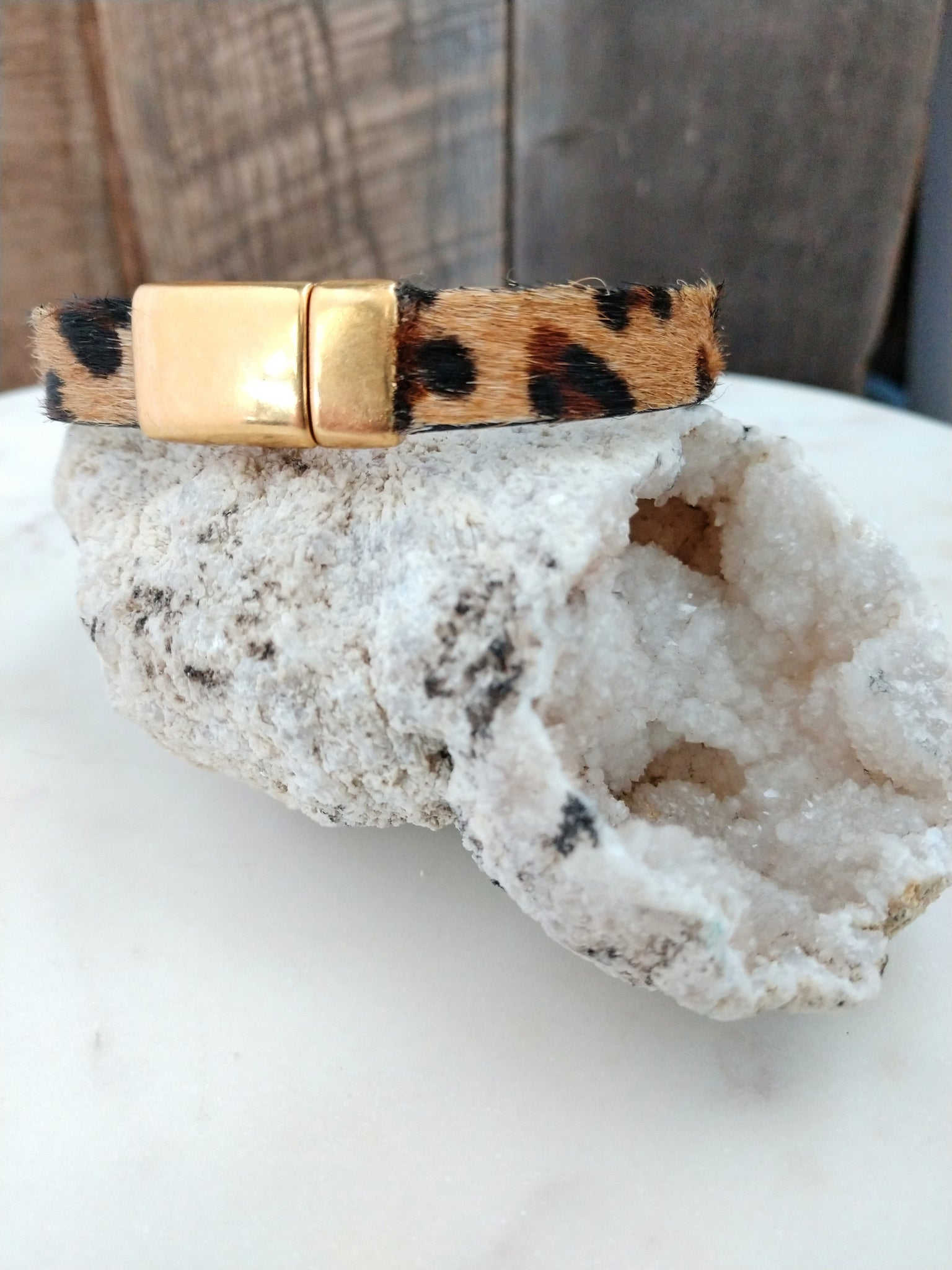 When is animal print *not* in style?! Stay classic and trendy with Kenya. This bracelet features leopard printed cow hair leather with a shiny gold-plated magnetic clasp.