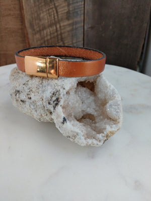 Metallic copper fine Italian leather is secured with a brassy rose gold magnetic clasp.