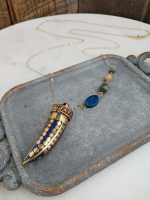 tibetan horn necklace | inlaid with lapis lazuli and accented with brass dots | Rare Soul jewelry