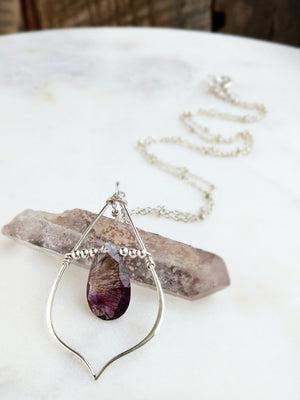 purple rain necklace featuring a royal lepidocrosite briolette wire wrapped to a sterling silver teardrop frame by Rare Soul accessories.