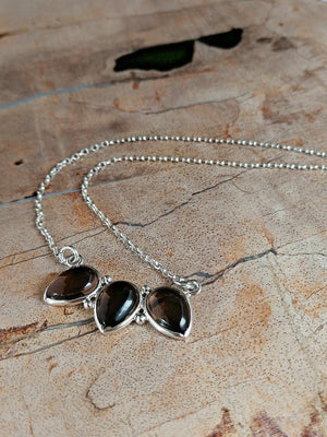 Smoke Screen necklace features a trio of smoky quartz on a sterling silver chain by Rare Soul accessories.
