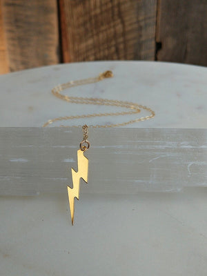 Gold lightning bolt necklace by Rare Soul accessories.