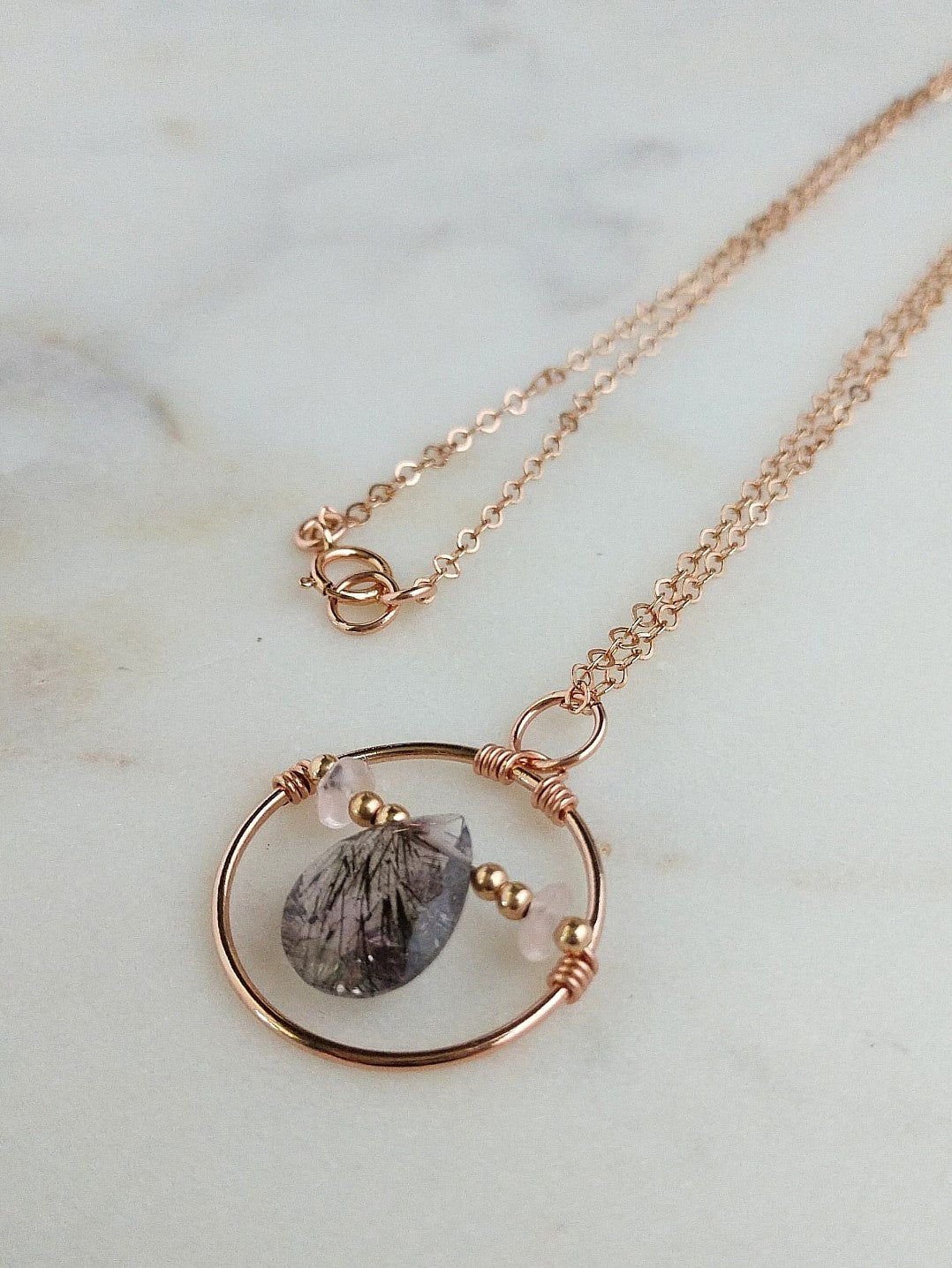 thaumatrope necklace with royal lepidocrosite, rose quartz, and rose gold fill.