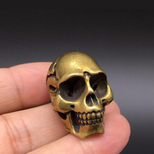 Load image into Gallery viewer, 🜪 Skull Figurine