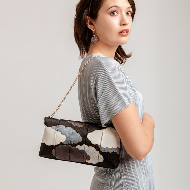 Kyoto Yuzen Silk Clutch in Black over Shoulder