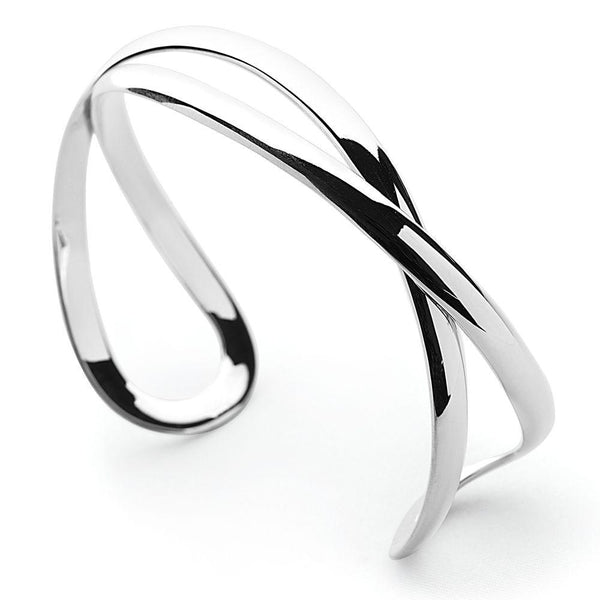 Sleek silver curves, timeless and endlessly versatile bangle