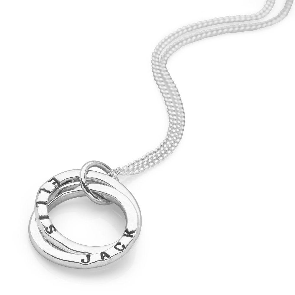 Two intertwined silver personalised rings on a curb chain