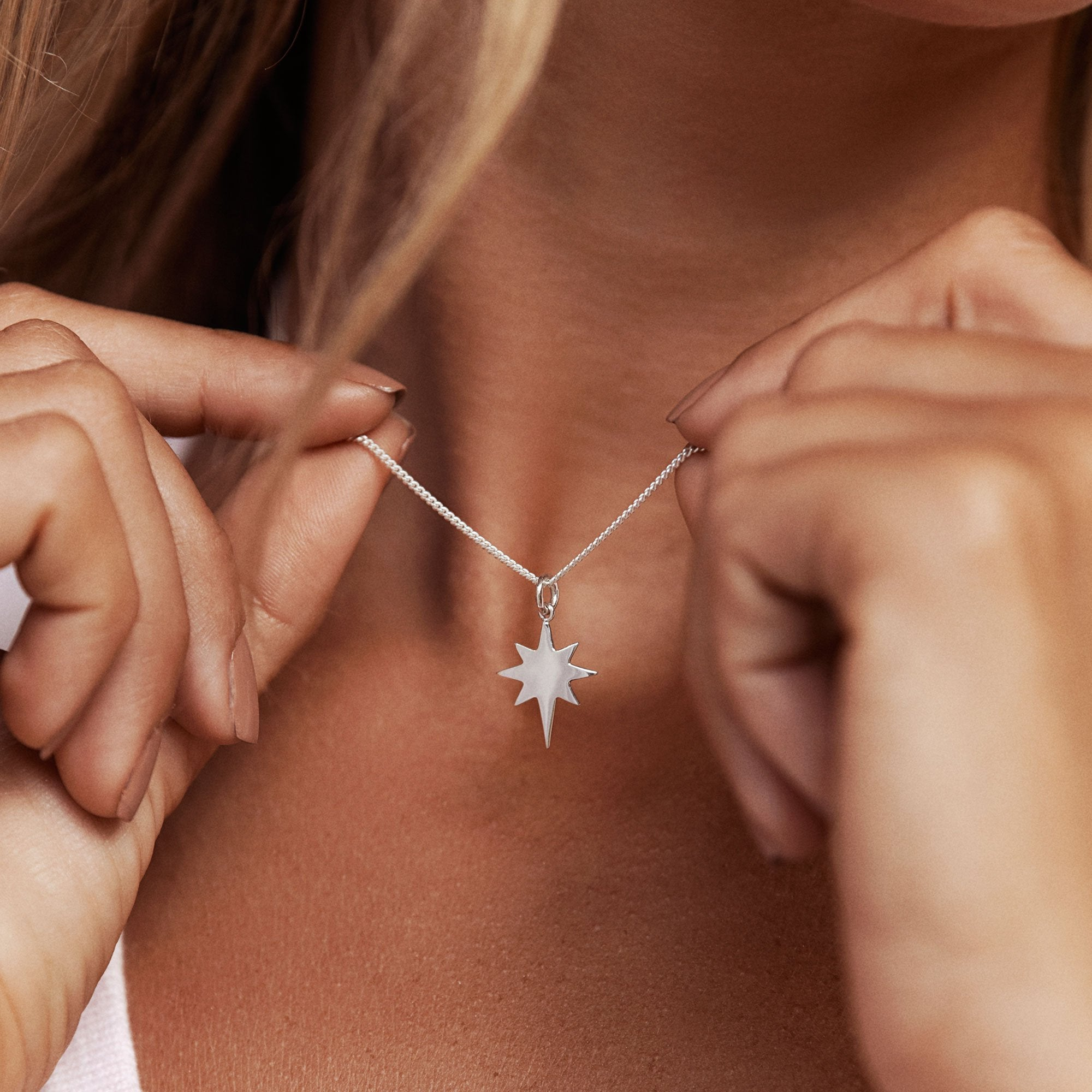 Model wearing 925 sterling silver north star pendant (P2761S1)