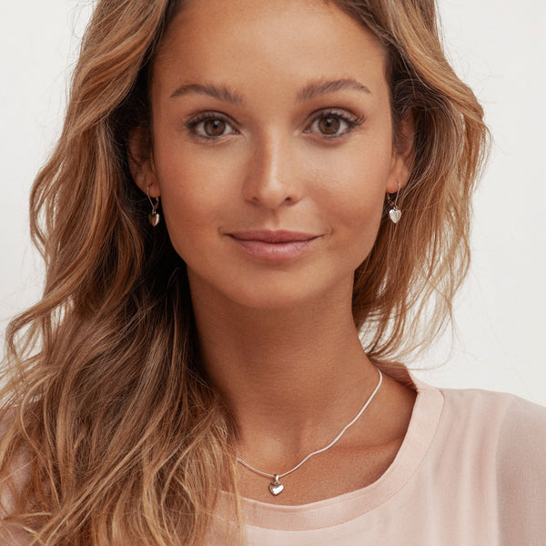 Model wearing 925 sterling silver heart pendant (P27821)