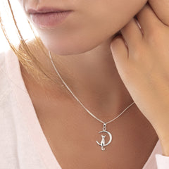 Model wearing 925 sterling silver cat in moon pendant (P27991)