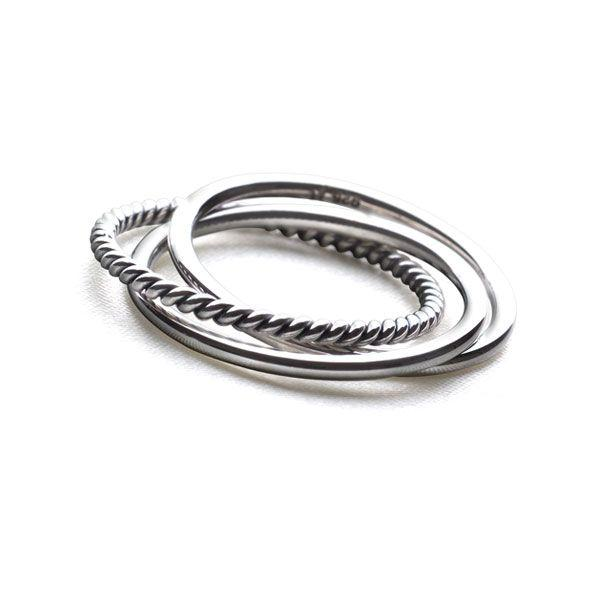 Three silver entwined bands, one twisted and two smooth