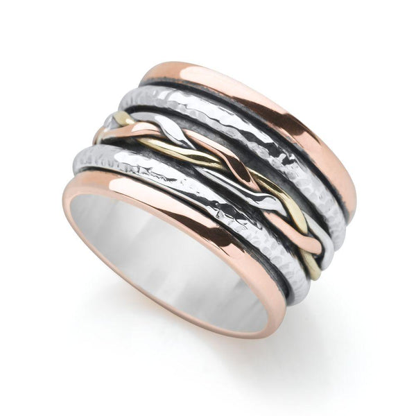Sterling silver and copper and brass plated silver, wrapped and woven with a hammered finished spin ring