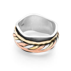 A wavy 925 sterling silver cuff, wrapped with bands of twisted silver, brass and copper which move freely spin ring